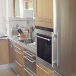 Cuisine-avec-facades-bois-et-aluminium-1-2-PPC-Pour-le-Privilege-de-Choisir